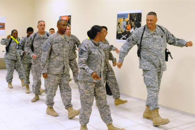 """Members of the 13th Sustainment Command (Expeditionary) participate in a team building exercise in which they were judged on how well they can dance to """"Cupid Shuffle."""" The 13th took first place in the contest Nov. 7 at Mirage, dining facility two, at Joint Base Balad, Iraq."""