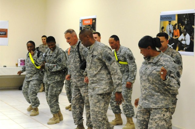 "Members of the 13th Sustainment Command (Expeditionary) participate in a team building exercise in which they were judged on how well they can dance to ""Cupid Shuffle."" The 13th took first place in the contest Nov. 7 at Mirage, dining facility two, at Joint Base Balad, Iraq."
