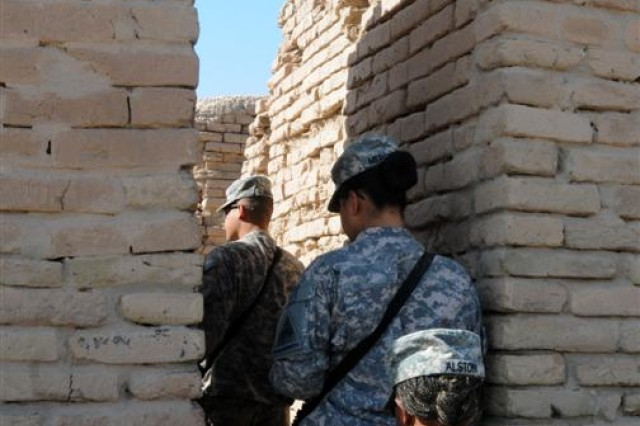 Soldiers with the 121st Brigade Support Battalion walk through an archway in the archaeological remains of Ur Nov. 12 near Contingency Operating Location Adder, Iraq.