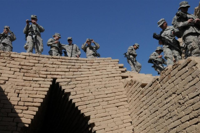 Soldiers with the 121st Brigade Support Battalion take pictures and walk down the stairs to see the tomb of Shulgi and Amur-Sin Nov. 12 at the archaeological remains of Ur near Contingency Operating Location Adder, Iraq.