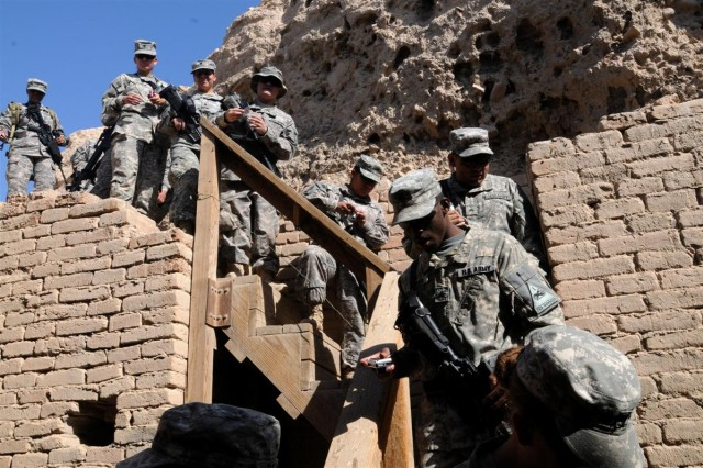 Soldiers with the 121st Brigade Support Battalion walk down stairs to see the tomb of Shulgi and Amur-Sin Nov. 12 at the archaeological remains of Ur near Contingency Operating Location Adder, Iraq.