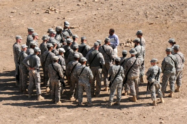 Soldiers from the 121st Brigade Support Battalion gather around their tour guide to learn more about the culture of the country in which they are deployed Nov. 12 at the archaeological remains of Ur near Contingency Operating Location Adder, Iraq.