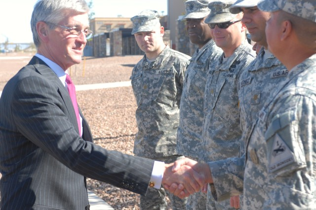 Secretary of the Army John McHugh meets with Soldiers from the 1st Heavy Brigade Combat Team, 1st Armored Division, at Fort Bliss, Texas, during a tour of the installation on Nov. 17, 2009.