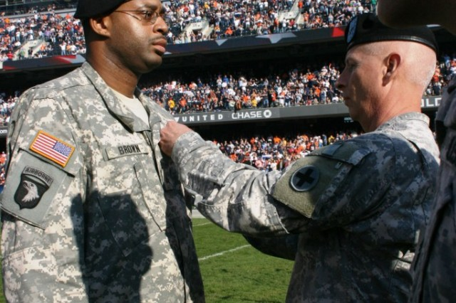 Illinois Army National Guard Deputy Commanding General, Brig. Gen. Steve Huber, pins the Purple Heart Medal on Sgt. Michael Brown at the 2009 Chicago Bears Veterans Day game on Sunday, 08 November. Brown's PH ceremony was during half-time in front of over 65 Thousand spectators at Soldier Field.