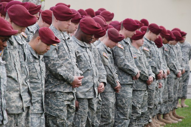 Soldiers of the 173rd Airborne Brigade Combat Team bow their heads during the invocation at a colors casing ceremony Nov. 10, at Vicenza, Italy. Spiritual fitness is one of the elements called for in the Comprehensive Soldier Fitness Program, a program that has leaders from various disciplines working together to build cohesion.