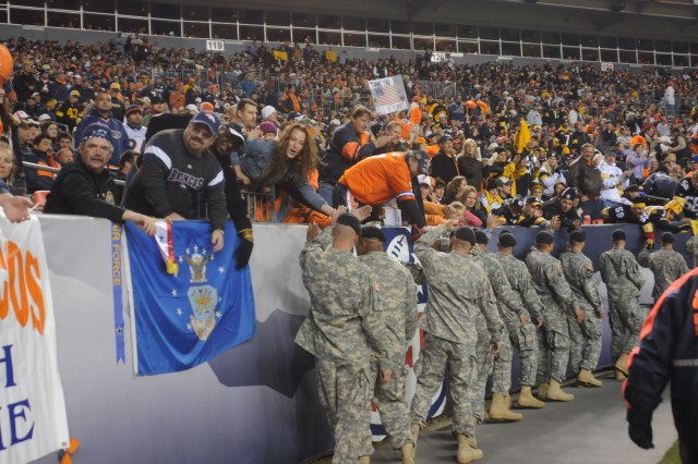 DENVER-Mountain Post Soldiers accept congratulations from football fans as they enter Invesco Field at Mile High in Denver Nov. 9 to take part in halftime ceremonies during the Pittsburgh Steelers versus Denver Broncos Monday Night Football game.