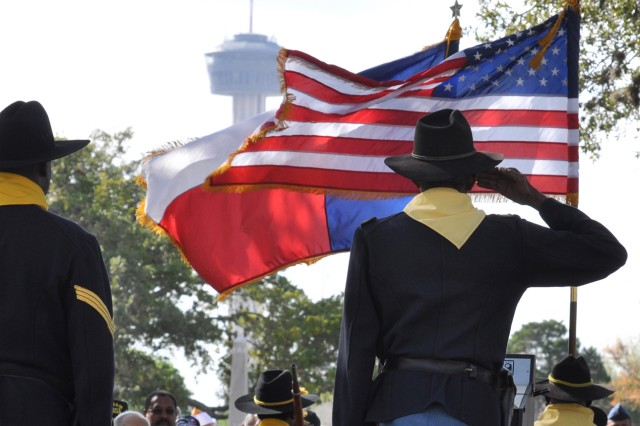 Buffalo Soldiers render a salute during the Veterans Day ceremony at the San Antonio National Cemetery.