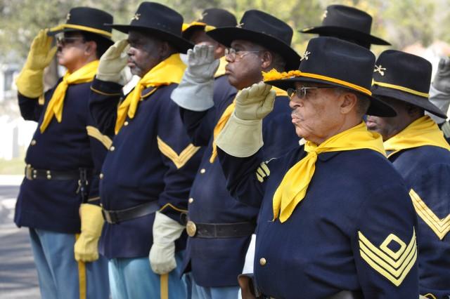 Buffalo Soldiers render salute as the colors pass the podium during the Buffalo Soldiers gathering at the National Cemetery on Veterans Day.
