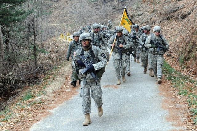 Hundreds of Soldiers participated in the 25-mile rucksack march known as the Manchu Mile March on Camp Casey.