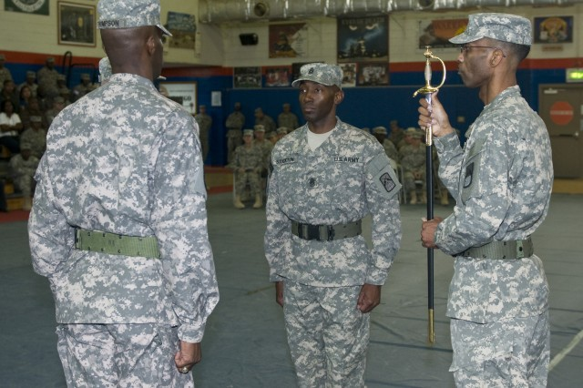 Master Sgt. Lester Long (right) of the 160th Signal Brigade prepares to pass the sword, a symbol of authority in the Noncommisioned Officer,  in a traditional Change of Responsibility Ceremony demonstrating the final duties of out-going Command Sgt. Maj. Kevin Thompson and the passing of leadership to Command Sgt. Maj. Kenneth Stockton.  The 160th Signal Brigade is responsible for providing Third Army with enterprise communication capabilities throughout Southwestern Asia and the Army Central area of responsibility.