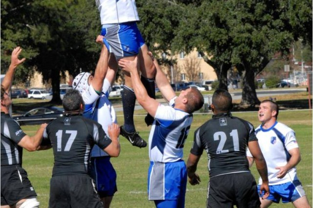 An Air Force player is lifted high in the air for an inbounds pass during the Armed Forces Rugby Championship final Nov. 13 at Fort Benning, Ga. Air Force captured its sixth straight title with a 34-0 victory.
