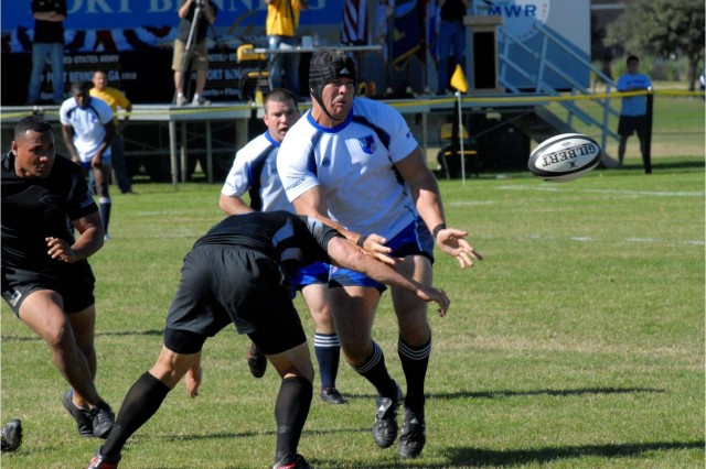 Army defenders converge on Air Force's Scott Marchant, who awaits a pitch during the second half of the Armed Forces Rugby Championship final Nov. 13 at Fort Benning, Ga. Air Force captured its sixth straight title with a 34-0 victory.