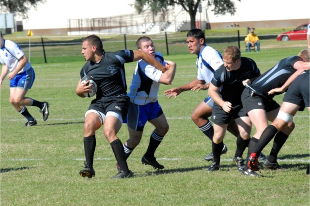 Army ball carrier Joseph Trepkowski looks for running room during the Armed Forces Rugby Championship final Nov. 13 at Fort Benning, Ga. Air Force captured its sixth straight title with a 34-0 victory.