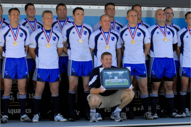 Air Force head coach Dan Lockert and his players celebrate the team's sixth straight Armed Forces Rugby Championship title Nov. 13 at Fort Benning, Ga.