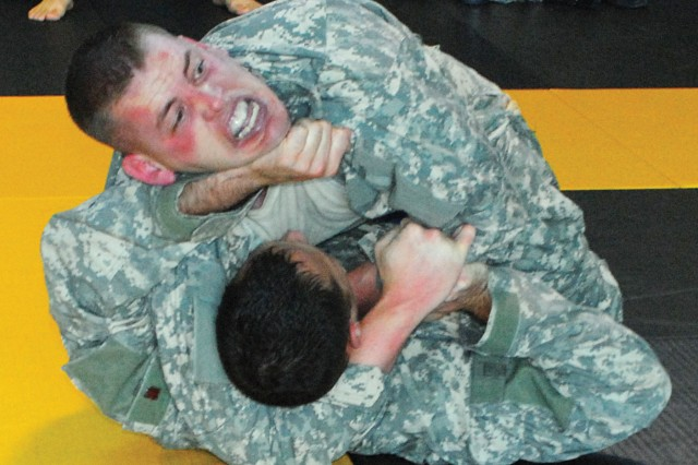 Capt. Keenan Ellison places a rear-naked chokehold on Capt. Chris Zagursky before beating him in one of the early bouts in the heavyweight division of a combatives tournament held on Fort Benning, Ga.