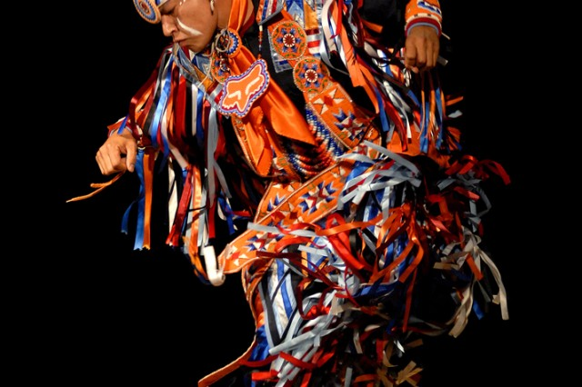 Arlen Whitebreast, with Native Pride Productions, performs a tribal dance to entertain guests at Joint Base-Myer Henderson Hall Wednesday in celebration of Native American Indian Heritage Month.