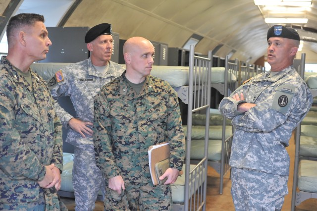 "Maj. Gen. Karl R. Horst, right, discusses the desirability of the military barracks at Camp Upshur for military personnel versus other government agencies seeking locations to relocate in their ""continuity of operations planning."" From left are Marine Col. Daniel J. Choika, commander of Marine Corps Base Quantico; Army Col. Richard Swengros, JFHQ-NCR/MDW J3, and Marine Lt. Col. Craig Wick, director of Quantico's Reserve Support Unit."