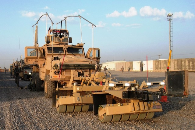 CONTINGENCY OPERATING LOCATION Q-WEST, Iraq - The lead vehicle in a column of gun trucks from A Company, 2nd Battalion, 198th Combined Arms, out of Hernando, Miss., waits to depart the Q-West Convoy Support Center yard on a mission Nov. 9.  This Mine-Resistant, Ambush-Protected scout truck is mounted with the Self-Protection Adaptive Roller Kit, or SPARKs, designed to absorb the damage of IEDs and shielding the vehicle and crew.