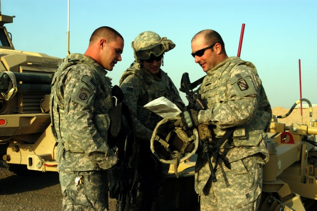 """CONTINGENCY OPERATING LOCATION Q-WEST, Iraq - Spec. Joshua M. Jenkins, a driver from Hernando, Miss., and Pfc. Hunter J. Brown, a gunner Starkville, Miss., listen as Sgt. Claybon Turner, assistant convoy commander from Eudora, Miss., briefs them before leaving COB Speicher to return to Q-West during a Nov. 9 convoy mission. All three are members of A Company, 2nd Battalion, 198th Combined Arms out of Hernando, Miss., Q-West's force protection company."""""""