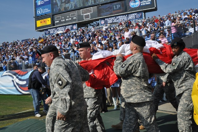 Soldiers of the 101st Airborne Division (Air Assault) of Fort Campbell, Ky., haul a football field-sized U.S. flag onto the field at the beginning of the game between the Tennessee Titans and Buffalo Bills.  The game recognized Veterans Day and the men and women, past and present, who have served their country in uniform.