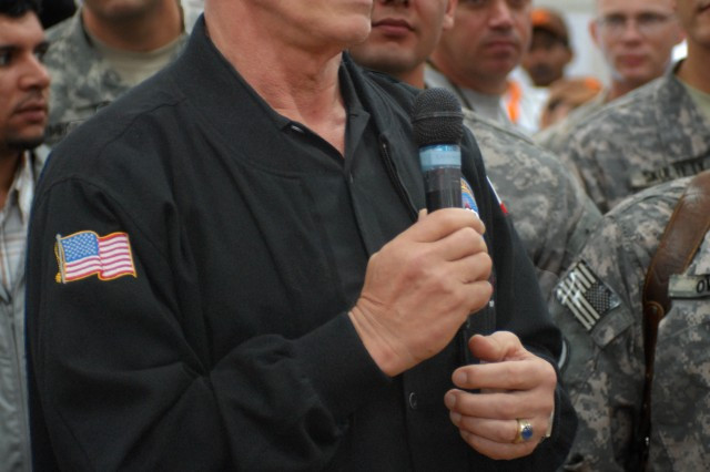 "California Gov. Arnold Schwarzenegger speaks to nearly 400 Servicemembers in Baghdad Nov. 16. The governor said he returned to Iraq to keep a promise he made to troops in 2003, when he told them ""I'll be back."""
