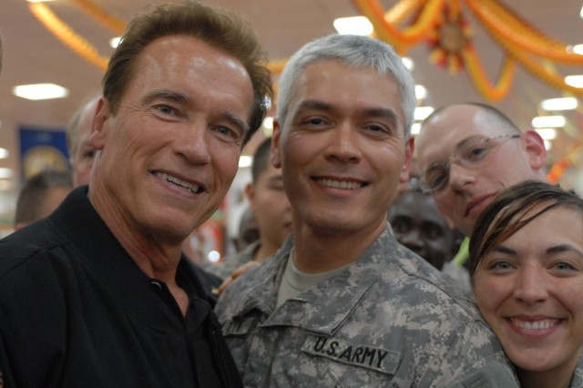 alifornia Gov. Arnold Schwarzenegger takes a moment to pose with Maj. Richard Skultety, Multi-National Corps-Iraq joint fires and effects cell battle major,  in Baghdad during his visit Nov. 16. In a packed Camp Victory chow hall, the governor thanked nearly 400 troops for the continued dedication to the mission here in Iraq.