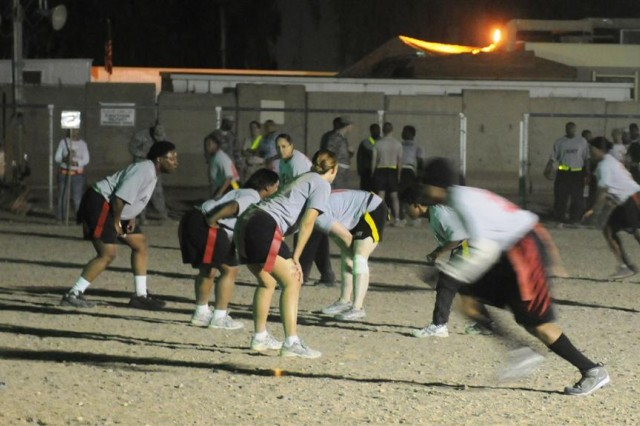 The Soulja Girlz, the 13th Sustainment Command (Expeditionary)'s powder puff football team, set out to defend the opponent's passing attack, during the game Nov. 14 at Joint Base Balad, Iraq.