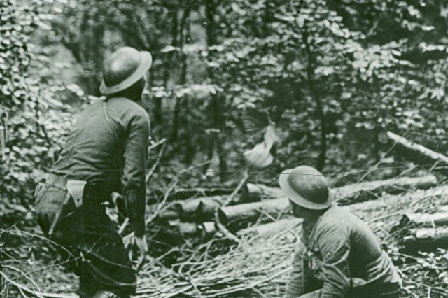 """On Winged Prayers! ; This image is captioned """"St. Pole, France; 13 May, 1918. Capt. R. Norris releasing pigeons in woods near post Comdr's dugout. Bn Hqs, 167th Inf, 42nd Div (formerly 4th Regt Inf, Ala National Guard)."""" (WWI Signal Corps Photograph Collection)."""