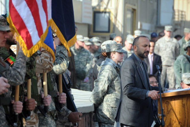 Afghan Minister of the Interior H.E. Minister Atmar address more than 400 coalition Soldiers, Sailors, Airmen, Marines, Department of Defense civilian employees and contractors, and partner nation representatives attending the change of command and the official activation of the NATO Training Mission - Afghanistan at Camp Eggers in Kabul, Nov. 21, 2009. During the ceremony, Lt. Gen. William B. Caldwell, IV, assumed command from  Maj. Gen. Richard P. Formica, prior to the activation of the new NTM-A that creates a unified command in charge of building capability and capacity within the Afghan Ministries of Defense and Interior.