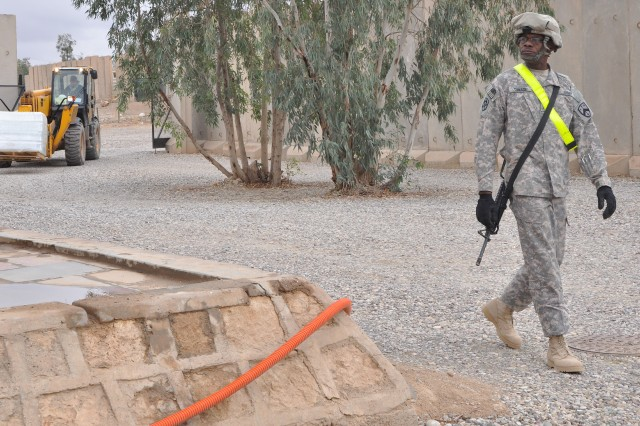 Sgt. Larry Turnage, an 1174th Transportation Company, 395th Combat Sustainment Support Battalion, 15th Sustainment Brigade, truck driver and Memphis, Tenn., native, guides a forklift delivering a pallet of water bottles to a work area here Nov. 18. (U.S. Army photo by Sgt. Matthew C. Cooley, 15th Sustainment Brigade public affairs)