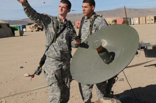 Soldiers discuss the direction of a satellite dish during the Warfighter Information Network-Tactical Increment Two Engineering Field Test at Fort Huachuca, Ariz., in December 2008