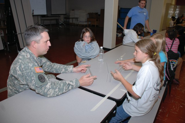 1st Space Brigade's Capt. Gary Kelly discusses the art of building bridges with students from the Galileo School of Math and Science. U.S. Army Space and Missile Defense Command/Army Forces Strategic Command has been in a partnership with the Colorado Springs school since March.