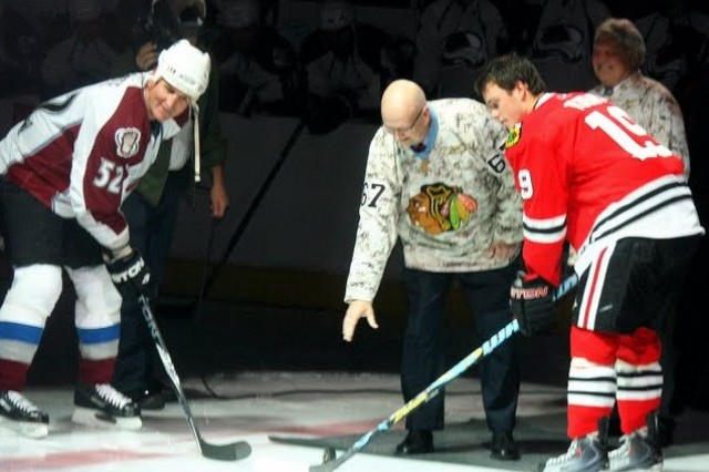 Medal of Honor Recipient, Al J. Lynch, drops the puck at the 2009 Chicago Blackhawks Veterans Day tribute on Wednesday, 11 November.  Lynch proudly wears the Blackhawks camouflage jersey for the occasion.