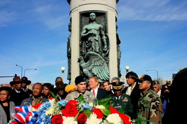 Maj. Gen. John F. Campbell, speaks at a ceremony on Veterans Day at the World War I, Black Soldiers Memorial, on Veterans Day, 2009. To his right is IL Senator Roland Burris and to his left is Retired Col. Eugene Scott, organzier of the African American Memorial Ceremony that invited Maj. Gen. Campbell to speak.