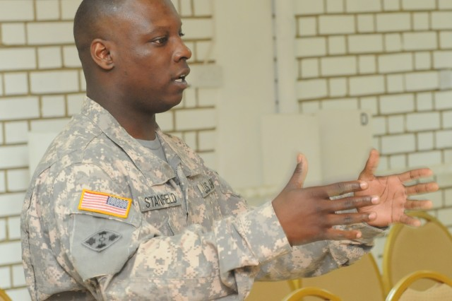 Staff Sgt. Joe Stanfield, brigade chaplain assistant, speaks to chaplains and their assistants during a religious support team training meeting.
