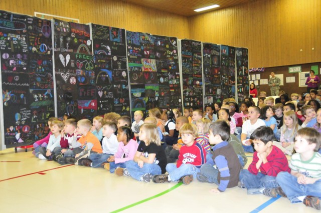 Grafenwoehr Elementary students stop to reflect, break down the Berlin wall