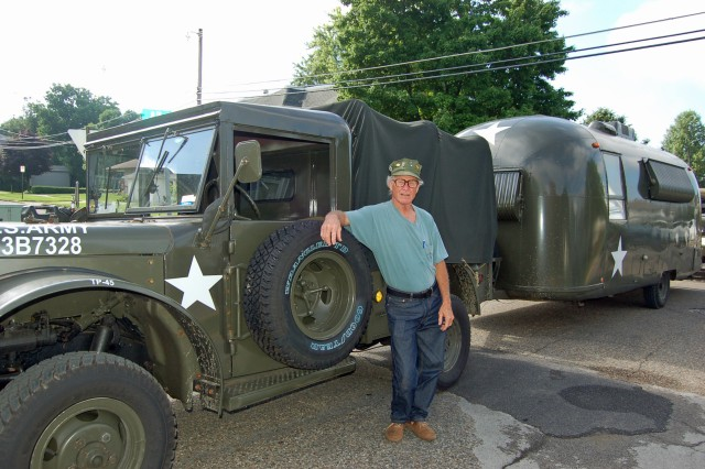 Chief Warrant Officer 2 Sonny Heath stands in front of his 1961 Dodge in Nebraska.