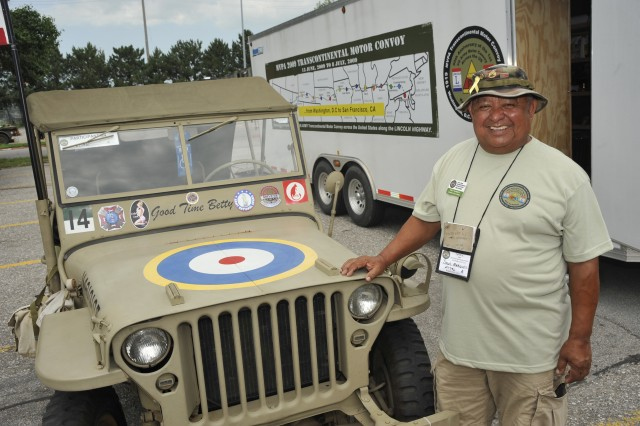 Retired Staff Sgt. Saul A. Marquez poses with his 1941 Willys jeep in Gretna, Neb.