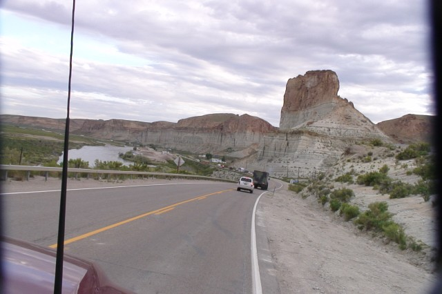 The convoy rolls past beautiful scenery.