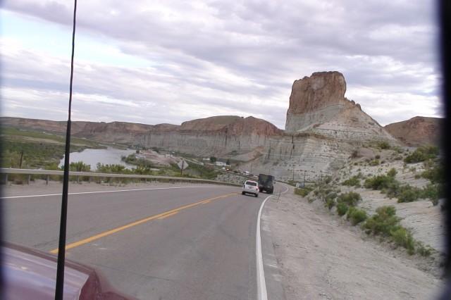 The convoy rolls past beautiful scenery.