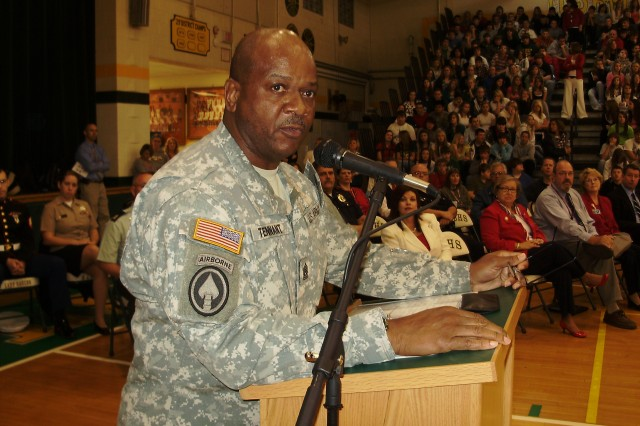 Command Sgt. Maj. Willie C. Tennant, Sr., 3d Sustainment Command (Expeditionary) Command Sgt. Maj., delivers a Veterans Day speech to the students and faculty of North Bullitt High School in Shepherdsville, Ky. Students from nearby Hebron Middle School were also in attendance, bringing the size of the audience to approximately 1600.  (U.S. Army photo by Sgt. 1st Class Dave McClain)