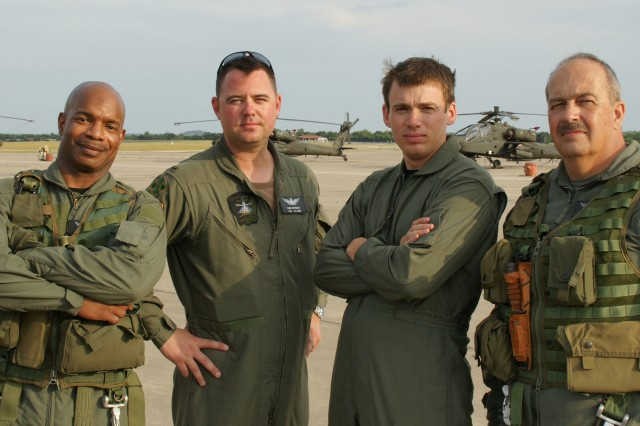 "Ken Thomas (far left), Chief Warrant Officer 4 John Covington, Frederic Doss and Chief Warrant Officer Ron Thompson (far right), pose during a break from filming on the set of ""G.I. Joe: The Rise of Cobra"" at Fort Hood, Texas."