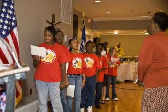 """The Anniston Army Depot's Mentoring Program teamed up with the Equal Employment Opportunity Office to provide a special performance of the national anthem. Here, mentees sing """"The Star-Spangled Banner."""""""