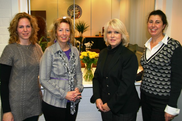 USAG Schinnen Directorate of Public Works housing and work order specialists are pleased to welcome newcomers in the refurbished Housing Referal Office that held a ribbon cutting ceremony Nov. 23, 2009. (Left to right) Susanne Van de Wal, Ilona Riemersma, Dorothy Hubbens, and Monique Wemmenhove.