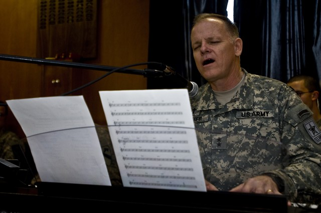 BAGHDAD - Chaplain (Maj. Gen.) Douglas Carver, The Army's chief chaplain, leads a congregation at Camp Liberty's Division Chapel through one of his favorite praise and worship songs, Nov. 22.