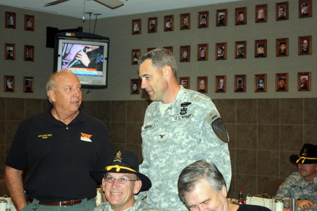 """Col. Brian Winski, commander of 4th Brigade Combat Team, 1st Cavalry Division """"Long Knives,"""" speaks to retired Col. Joe Bowen during breakfast at Fort Hood's Operation Iraqi Freedom dining facility Nov. 10.  The breakfast was part of a Veteran's day tribute and effort to reach out to the local community."""