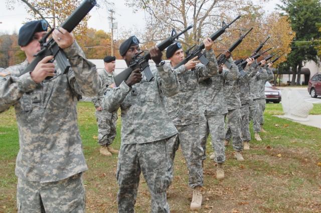 Seven riflemen fire three volleys each - a 21-gun salute - at the Nov. 5 memorial for Sgt. 1st Class Fernando Preciado.