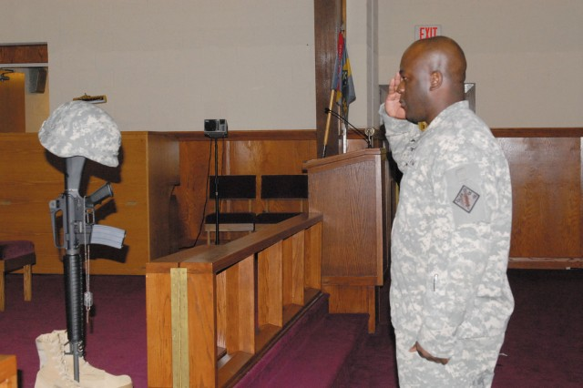Captain Norven Charles, Headquarters and Headquarters Company commander, 20th Support Command (CBRNE), renders a final salute to Sgt. 1st Class Fernando Preciado during a memorial ceremony at Aberdeen Proving Ground Nov. 5.