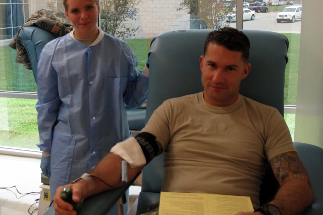 Sgt. 1st Class Darin Morgan worked with Pvt. 1st Class Alicia Brown during the 120th Infantry Brigade blood drive at Fort Hood, Wednesday, October 28, 2009.
