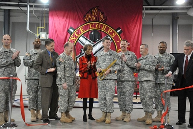 Participants in the Rozier Hall Dedication cut the ceremonial ribbon.  Shown from left to right, Col. Andrew W. Backus, Commander, US Army Corps of Engineers Norfolk District; Command Sgt. Maj. C.C. Jenkins, Command Sergeant Major, US Army Combined Arms Support Command; Mr. William Moore, Deputy to the Commanding General, US Army Combined Arms Support Command; Lt. Gen. Mitchell H. Stevenson, Deputy Chief of Staff of the Army for Logisticis, G-4; Mrs. Joyce Rozier, widow of the late Maj. Gen. Jackson Rozier; Brig. Gen. Lynn. A. Collyar, Commandant and Commanding General, US Army Ordnance School; Chief Warrant Officer 5 Arthur Dahl, Ordnance Regimental Warrant Officer; Col. Dan Reilly, Commander, 61st Ordnance Brigade; Command Sgt. Maj. Robert A. Tolbert, Command Sergeant Major, 61st Ordnance Brigade; Mr. Gary F. Neuser, Director, Tactical Support Equipment Department.